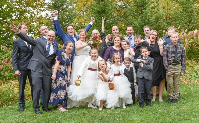 Image of large wedding party at outdoor wedding ceremony